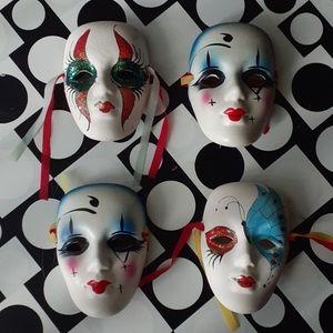 Three hanging face masks